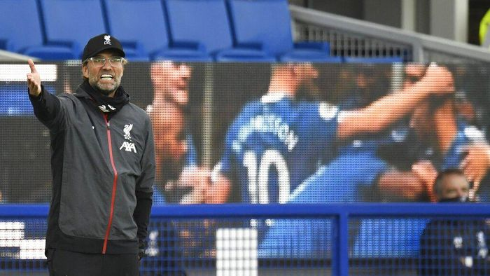 Liverpools manager Jurgen Klopp shouts during the English Premier League soccer match between Everton and Liverpool at Goodison Park in Liverpool, England, Sunday, June 21, 2020. (Peter Powell/Pool via AP)