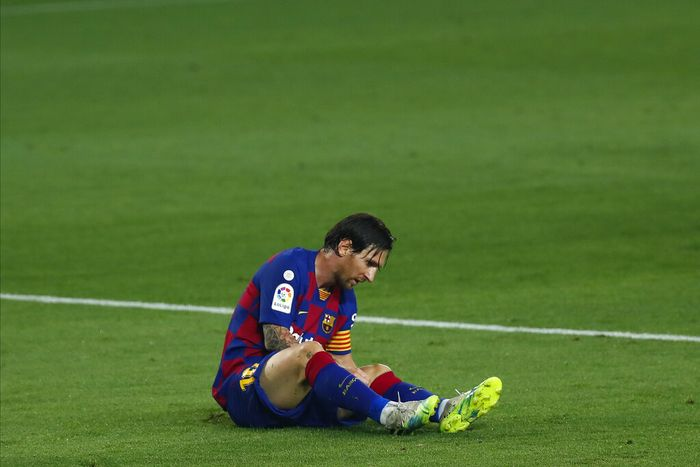 Barcelonas Lionel Messi lies on the pitch during the Spanish La Liga soccer match between FC Barcelona and Athletic Bilbao at the Camp Nou stadium in Barcelona, Spain, Tuesday, June 23, 2020. (AP Photo/Joan Monfort)