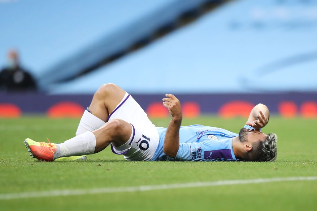 MANCHESTER, ENGLAND - JUNE 22: Sergio Aguero of Manchester City lies on the pitch injured during the Premier League match between Manchester City and Burnley FC at Etihad Stadium on June 22, 2020 in Manchester, England. Football stadiums around Europe remain empty due to the Coronavirus Pandemic as Government social distancing laws prohibit fans inside venus resulting in all fixtures being played behind closed doors. (Photo by Martin Rickett/Pool via Getty Images)
