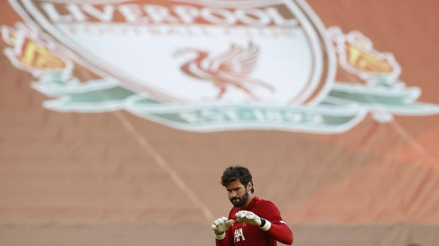 Liverpool's goalkeeper Alisson before the English Premier League soccer match between Liverpool and Crystal Palace at Anfield Stadium in Liverpool, England, Wednesday, June 24, 2020. (/Pool via AP)
