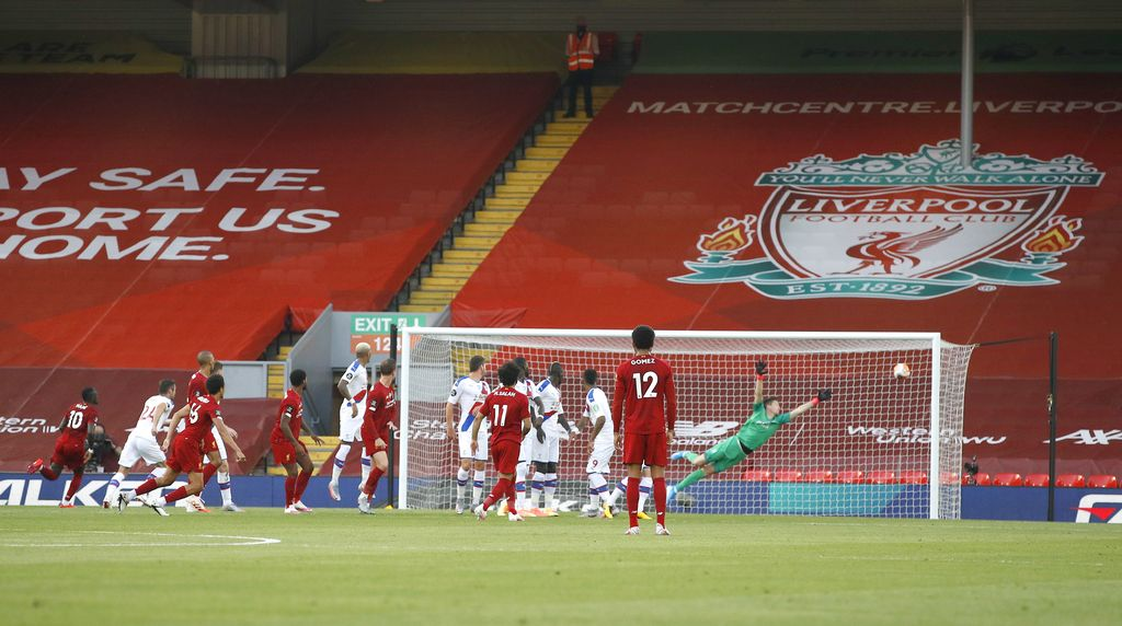 LIVERPOOL, ENGLAND - JUNE 24: Trent Alexander-Arnold of Liverpool scores his teams first goal from a free kick during the Premier League match between Liverpool FC and Crystal Palace at Anfield on June 24, 2020 in Liverpool, England. (Phil Noble/Pool via Getty Images)