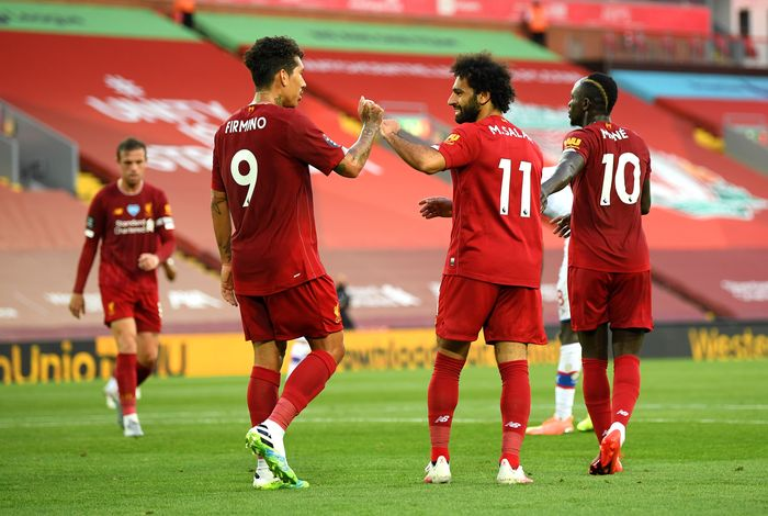 LIVERPOOL, ENGLAND - JUNE 24: Mohamed Salah of Liverpool celebrates with Roberto Firmino of Liverpool after scoring his teams second goal during the Premier League match between Liverpool FC and Crystal Palace at Anfield on June 24, 2020 in Liverpool, England. (Photo by Shaun Botterill/Getty Images)
