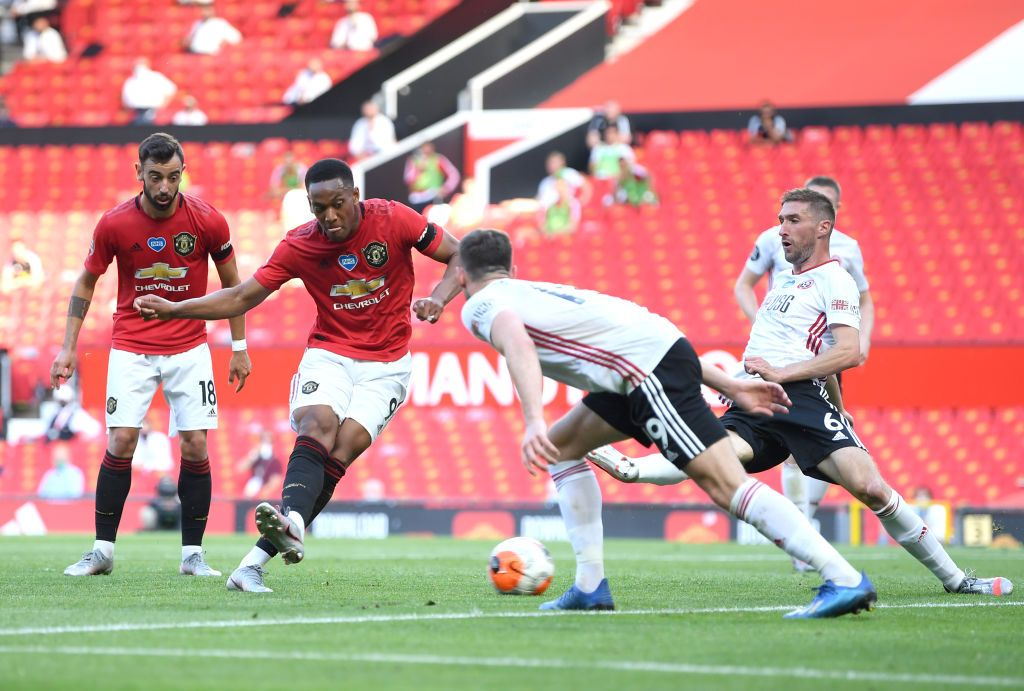 MANCHESTER, ENGLAND - JUNE 24: Anthony Martial of Manchester United scores his team's second goal during the Premier League match between Manchester United and Sheffield United at Old Trafford on June 24, 2020 in Manchester, England. (Photo by Michael Regan/Getty Images)