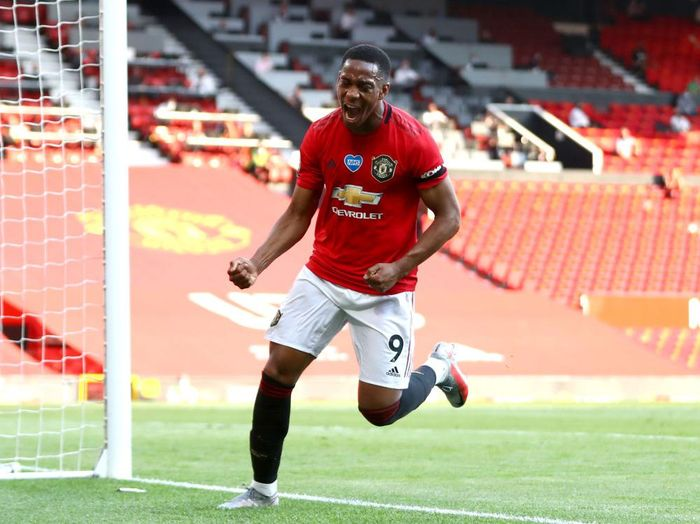 MANCHESTER, ENGLAND - JUNE 24: Anthony Martial of Manchester United celebrates after he scores his teams third goal during the Premier League match between Manchester United and Sheffield United at Old Trafford on June 24, 2020 in Manchester, England. (Photo by Michael Steele/Getty Images)