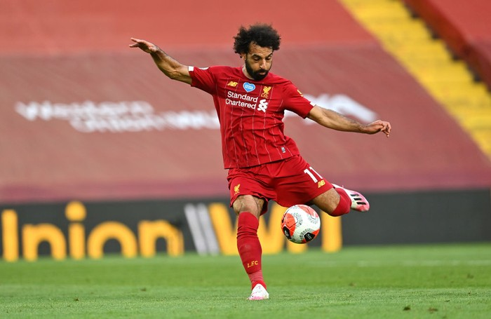 LIVERPOOL, ENGLAND - JUNE 24: Mohamed Salah of Liverpool scores his sides second goal during the Premier League match between Liverpool FC and Crystal Palace at Anfield on June 24, 2020 in Liverpool, England. (Photo by Paul Ellis/Pool via Getty Images)