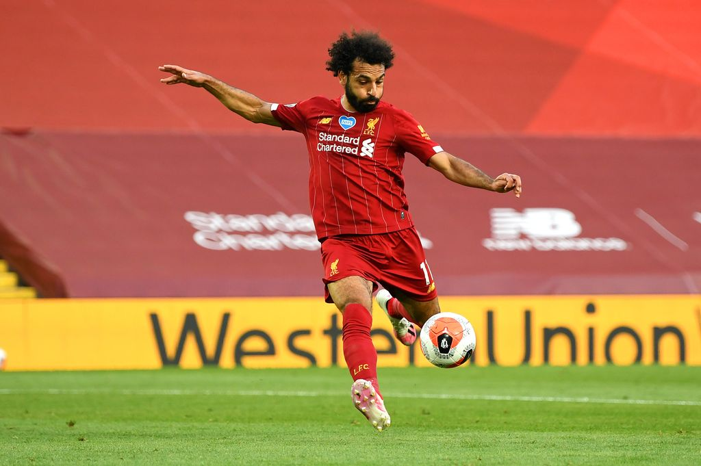 LIVERPOOL, ENGLAND - JUNE 24: Mohamed Salah of Liverpool celebrates after scoring his teams second goal during the Premier League match between Liverpool FC and Crystal Palace at Anfield on June 24, 2020 in Liverpool, England. (Photo by Paul Ellis/Pool via Getty Images)