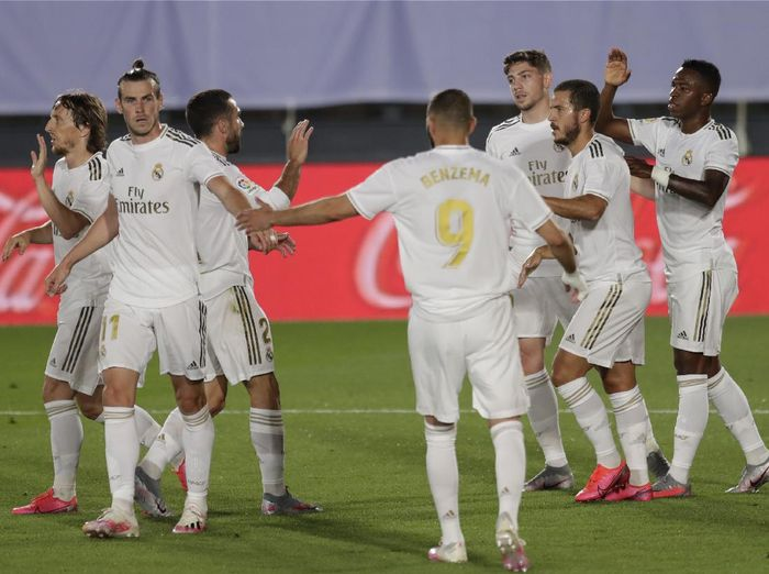 Real Madrids Vinicius Junior, right, celebrates after scoring the opening goal with teammates during the Spanish La Liga soccer match between Real Madrid and Mallorca at Alfredo di Stefano stadium in Madrid, Spain, Wednesday, June 24, 2020. (AP Photo/Bernat Armangue)