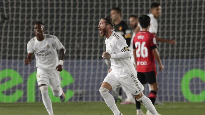 Real Madrids Sergio Ramos celebrates after scoring his sides second goal during the Spanish La Liga soccer match between Real Madrid and Mallorca at Alfredo di Stefano stadium in Madrid, Spain, Wednesday, June 24, 2020. (AP Photo/Bernat Armangue)