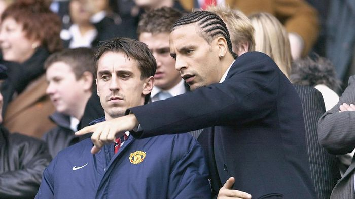 MANCHESTER, ENGLAND - MARCH 14:  Rio Ferdinand and Gary Neville of Manchester United watch from the stands during the FA Barclaycard Premiership match between Manchester City and Manchester United at The City of Manchester Stadium on March 14, 2004 in Manchester, England.  (Photo by Alex Livesey/Getty Images)