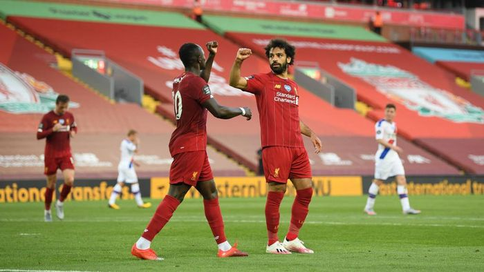 LIVERPOOL, ENGLAND - JUNE 24:  Mohamed Salah of Liverpool celebrates with Sadio Mane of Liverpool after scoring his sides second goal during the Premier League match between Liverpool FC and Crystal Palace at Anfield on June 24, 2020 in Liverpool, England. (Photo by Shaun Botterill/Getty Images)