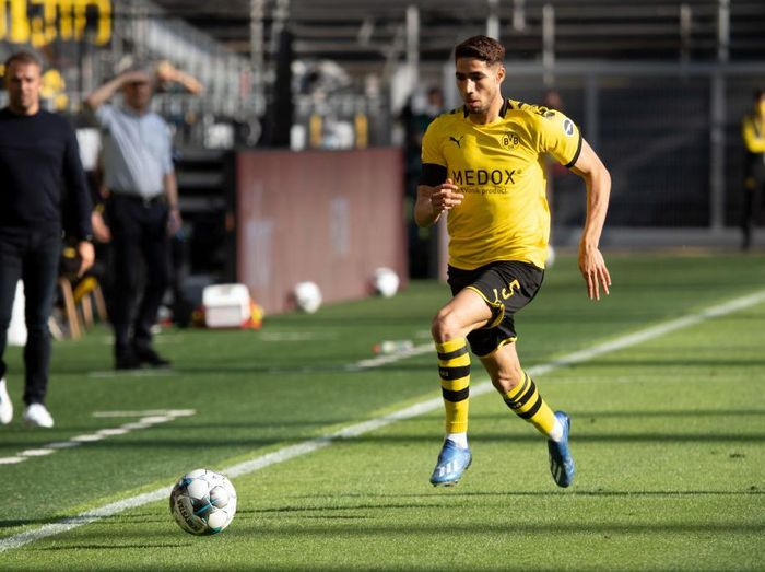 DORTMUND, GERMANY - MAY 26: Achraf Hakimi of Borussia Dortmund runs with the ball during the Bundesliga match between Borussia Dortmund and FC Bayern Muenchen at Signal Iduna Park on May 26, 2020 in Dortmund, Germany. (Photo by Federico Gambarini/Pool via Getty Images)