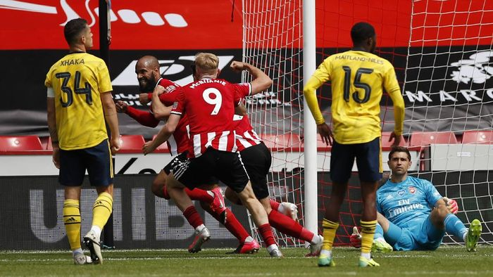 SHEFFIELD, ENGLAND - JUNE 28: David McGoldrick of Sheffield United celebrates after he scores his teams first goal during the FA Cup Fifth Quarter Final match between Sheffield United and Arsenal FC at Bramall Lane on June 28, 2020 in Sheffield, England. (Photo by Andrew Boyers/Pool via Getty Images)