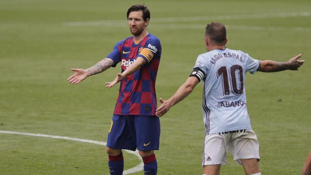 Barcelona's Lionel Messi gestures during a Spanish La Liga soccer match between RC Celta and Barcelona at the Balaidos stadium in Vigo, Spain, Saturday, June 27, 2020. (AP Photo/Lalo Villar)