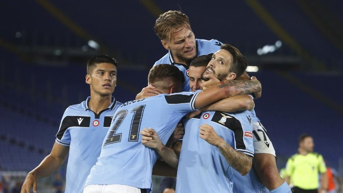 Lazios Luis Alberto, right, celebrates with his teammates Sergej Milinkovic-Savic,Adam Marusic and Ciro Immobile, on top, after scoring his sides second goal during a Serie A soccer match between Lazio and Fiorentina at Romes Olympic stadium, Saturday, June 27, 2020. (AP Photo/Riccardo de Luca)