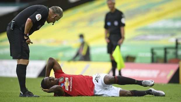 Manchester United's Odion Ighalo reacts after a challenge during the FA Cup sixth round soccer match between Norwich City and Manchester United at Carrow Road stadium in Norwich, England, Saturday, June 27, 2020. (Joe Giddens/Pool via AP)