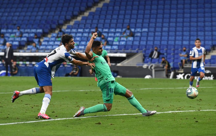 BARCELONA, SPAIN - JUNE 28: Casemiro of Real Madrid scores his sides first goal during the Liga match between RCD Espanyol and Real Madrid CF at RCDE Stadium on June 28, 2020 in Barcelona, Spain. (Photo by David Ramos/Getty Images)