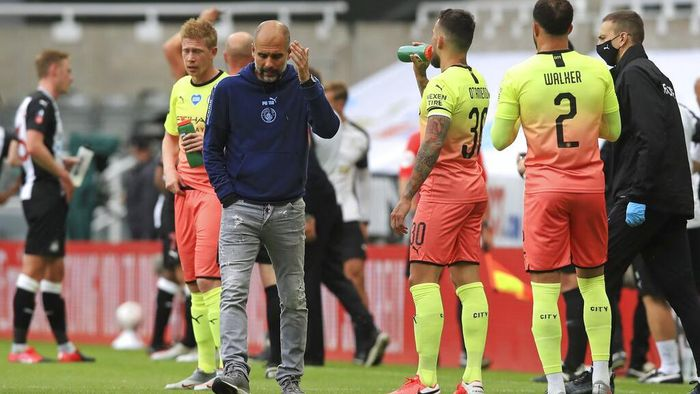 Manchester Citys head coach Pep Guardiola reacts during a drinks break during the FA Cup sixth round soccer match between Newcastle United and Manchester City at St. James Park in Newcastle, England, Sunday, June 28, 2020. (Owen Humphreys/Pool via AP)