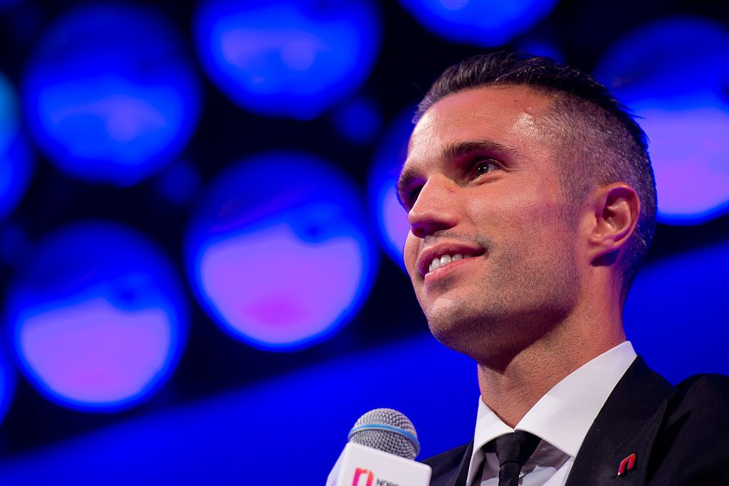 LONDON, ENGLAND - OCTOBER 05:  Robin van Persie speaks on stage during the 21st Legends of football event to celebrate 25 seasons of the Premier League and raise money for music therapy charity Nordoff Robbins at The Grosvenor House Hotel  (Photo by Ben A. Pruchnie/Getty Images for Premier League)