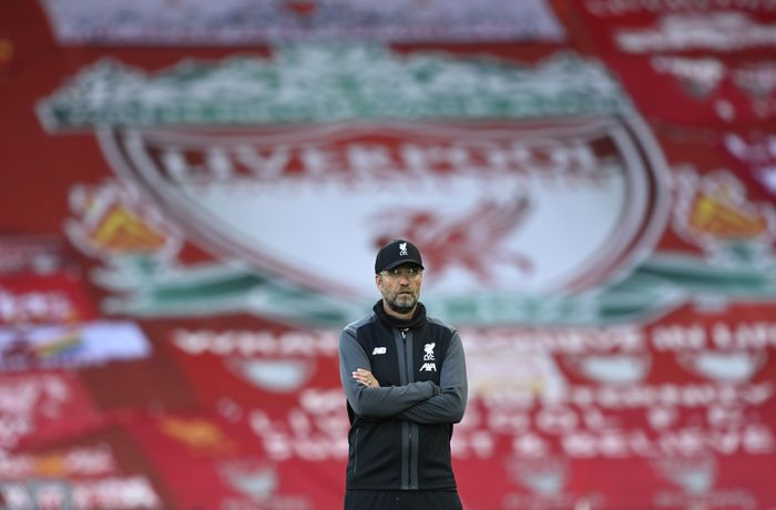 Liverpools manager Jurgen Klopp stands on the pitch before the English Premier League soccer match between Liverpool and Crystal Palace at Anfield Stadium in Liverpool, England, Wednesday, June 24, 2020. (Shaun Botterill/Pool via AP)
