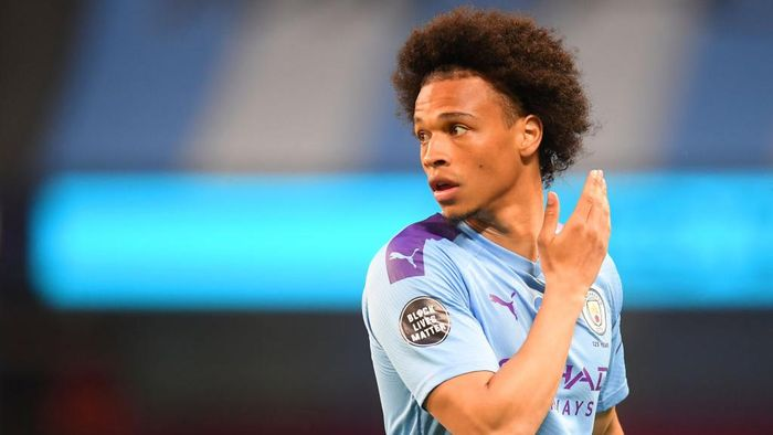 MANCHESTER, ENGLAND - JUNE 22: Leroy Sane of Manchester City looks on while showing the Black Lives Matter movement logo on his shirt sleeve during the Premier League match between Manchester City and Burnley FC at Etihad Stadium on June 22, 2020 in Manchester, England. Football stadiums around Europe remain empty due to the Coronavirus Pandemic as Government social distancing laws prohibit fans inside venus resulting in all fixtures being played behind closed doors. (Photo by Michael Regan/Getty Images)