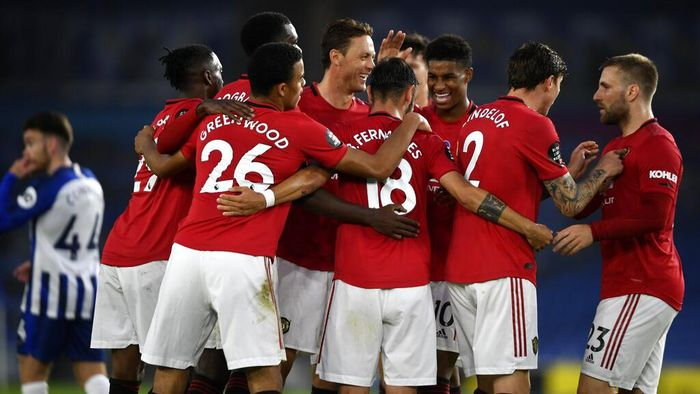 Manchester United players celebrate the second goal of their team during the English Premier League soccer match between Brighton & Hove Albion and Manchester United at the AMEX Stadium in Brighton, England, Tuesday, June 30, 2020. (Mike Hewitt/Pool via AP)