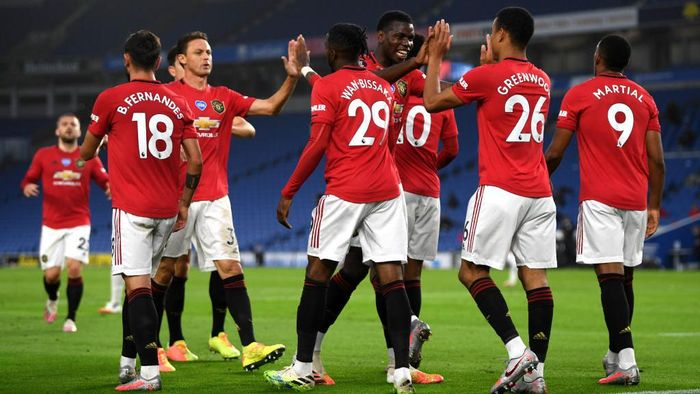 BRIGHTON, ENGLAND - JUNE 30: Paul Pogba of Manchester United   congratulates Mason Greenwood on scoring the opening goal during the Premier League match between Brighton & Hove Albion and Manchester United at American Express Community Stadium on June 30, 2020 in Brighton, United Kingdom. (Photo by Mike Hewitt/Getty Images)