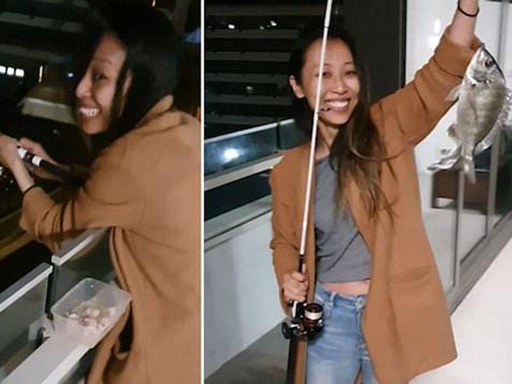 Santuy! Ngidam Makan Ikan, Wanita Ini Pancing Ikan dari Balkon Rumahnya