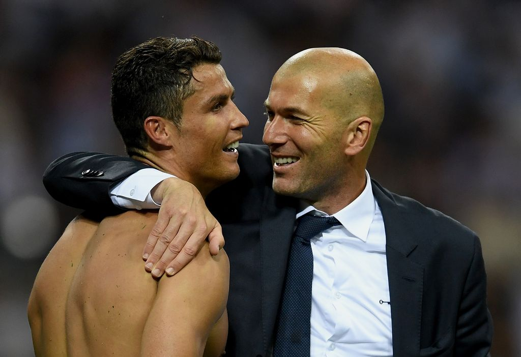 MILAN, ITALY - MAY 28:  Real Madrid head coach Zinedine Zidane hugs a smiling Cristiano Ronaldo of Real Madrid after the UEFA Champions League Final match between Real Madrid and Club Atletico de Madrid at Stadio Giuseppe Meazza on May 28, 2016 in Milan, Italy.  (Photo by Laurence Griffiths/Getty Images)