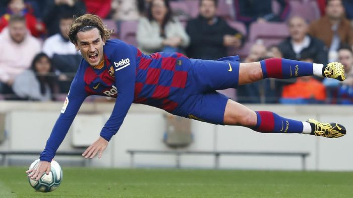 FILE - In this file photo dated Saturday Feb. 22, 2020, Barcelonas Antoine Griezmann falls during a Spanish La Liga soccer match against Eibar at the Camp Nou stadium in Barcelona, Spain.  Griezmann arrived to Camp Nou last summer with the task of completing an intimidating strike trio with Messi and Suárez, but one year later, the French world champion can barely get on the pitch, and was left out of Barcelona's starting 11 on Tuesday June 30, 2020.  (AP Photo/Joan Monfort, FILE)