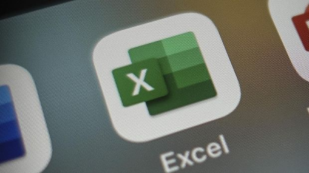 Italy, Rome - January 15 2020: The icon of the Excel app for iOS surrounded by some other office applications such as: Numbers (competitor app) and Power Point. Excel is part of office 365 suite.