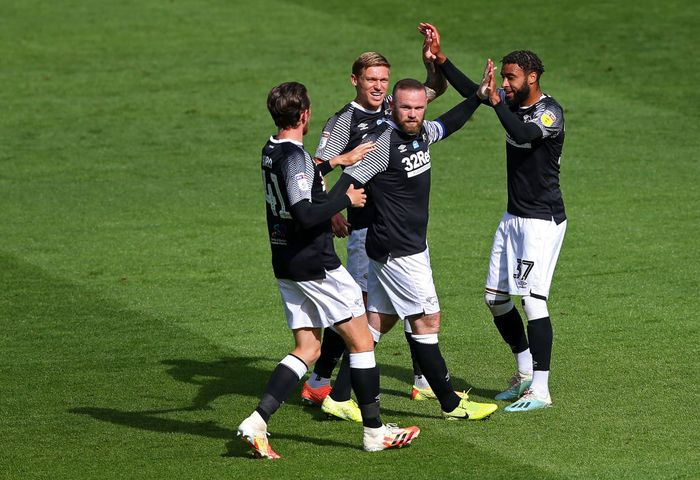 PRESTON, ENGLAND - JULY 01:  Wayne Rooney of Derby County celebrates with team mates after scoring the opening goal during the Sky Bet Championship match between Preston North End and Derby County at Deepdale on July 01, 2020 in Preston, England. (Photo by Alex Livesey/Getty Images)