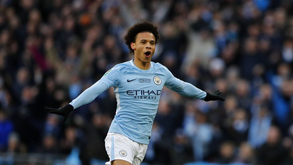 FILE-In this Feb. 25, 2018 file photo Manchester City's Leroy Sane celebrates during the English League Cup final soccer match between Arsenal and Manchester City at Wembley Stadium in London. Leroy Sane moves from Manchester City to Bayern Munich. The 24-year-old signs a five-year contract in Munich. (AP Photo/Frank Augstein)