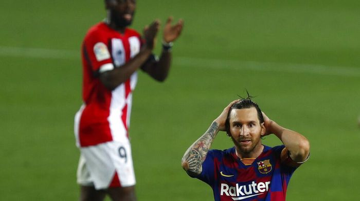 Barcelonas Lionel Messi gestures during the Spanish La Liga soccer match between FC Barcelona and Athletic Bilbao at the Camp Nou stadium in Barcelona, Spain, Tuesday, June 23, 2020. (AP Photo/Joan Monfort)