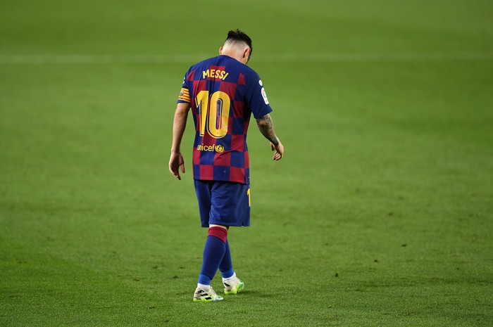 BARCELONA, SPAIN - JUNE 30: Lionel Messi of FC Barcelona walks over the pitch during the Liga match between FC Barcelona and Club Atletico de Madrid at Camp Nou on June 30, 2020 in Barcelona, Spain. (Photo by David Ramos/Getty Images)