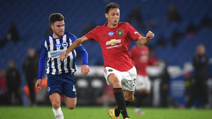 BRIGHTON, ENGLAND - JUNE 30: Nemanja Matic of Manchester United holds off Aaron Connelly of Brighton during the Premier League match between Brighton & Hove Albion and Manchester United at American Express Community Stadium on June 30, 2020 in Brighton, United Kingdom. Football Stadiums around Europe remain empty due to the Coronavirus Pandemic as Government social distancing laws prohibit fans inside venues resulting in games being played behind closed doors. (Photo by Mike Hewitt/Getty Images)