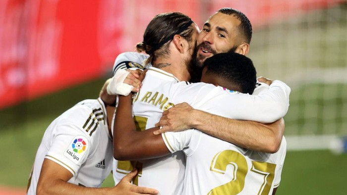 MADRID, SPAIN - JULY 02: Sergio Ramos of Real Madrid celebrates his teams first goal with teammates during the Liga match between Real Madrid CF and Getafe CF at Estadio Alfredo Di Stefano on July 02, 2020 in Madrid, Spain. Football Stadiums around Europe remain empty due to the Coronavirus Pandemic as Government social distancing laws prohibit fans inside venues resulting in all fixtures being played behind closed doors. (Photo by Angel Martinez/Getty Images)