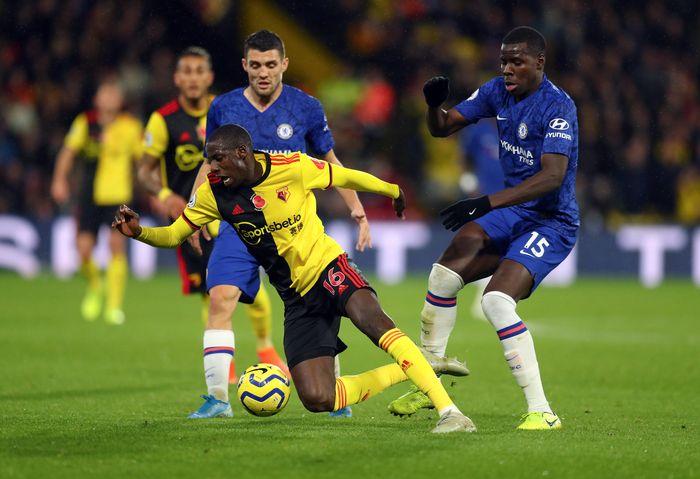 WATFORD, ENGLAND - NOVEMBER 02: Abdoulaye Doucoure of Watford is tackled by Kurt Zouma of Chelsea during the Premier League match between Watford FC and Chelsea FC at Vicarage Road on November 02, 2019 in Watford, United Kingdom. (Photo by Catherine Ivill/Getty Images)