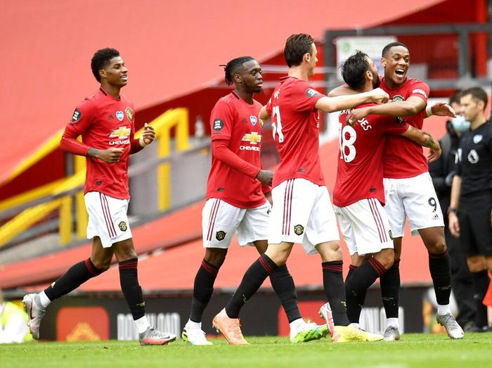 Manchester Uniteds Anthony Martial (9) is congratulated by teammates after scoring a goal during the English Premier League soccer match between Manchester United and Bournemouth at Old Trafford stadium in Manchester, England, Saturday, July 4, 2020. (Peter Powell/Pool via AP)