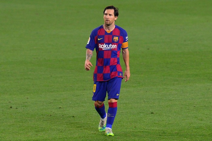 Barcelonas Argentinian forward Lionel Messi walks on the pitch during the Spanish league football match between FC Barcelona and Athletic Club Bilbao at the Camp Nou stadium in Barcelona on June 23, 2020. (Photo by Pau BARRENA / AFP)