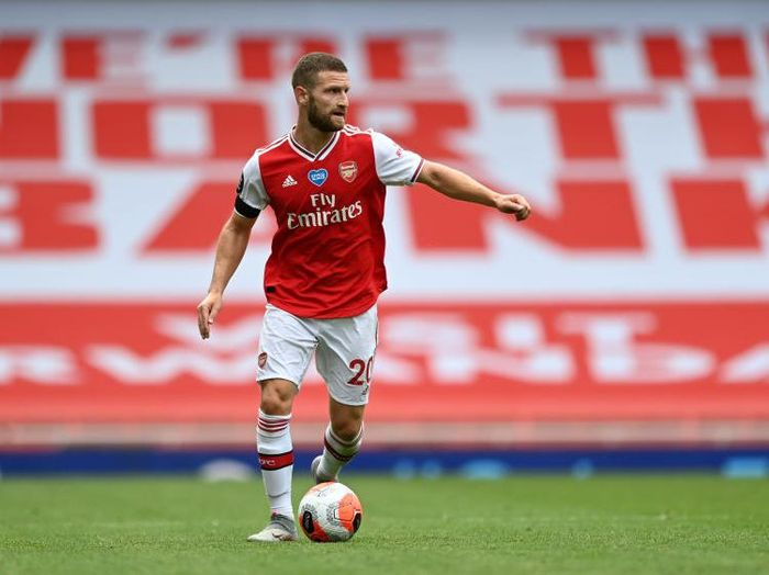 LONDON, ENGLAND - JULY 01: Shkodran Mustafi of Arsenal controls the ball during the Premier League match between Arsenal FC and Norwich City at Emirates Stadium on July 01, 2020 in London, England. Football Stadiums around Europe remain empty due to the Coronavirus Pandemic as Government social distancing laws prohibit fans inside venues resulting in all fixtures being played behind closed doors. (Photo by Shaun Botterill/Getty Images)