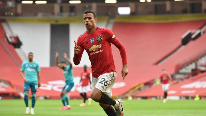 MANCHESTER, ENGLAND - JULY 04: Mason Greenwood of Manchester United celebrates after scoring his teams fourth goal during the Premier League match between Manchester United and AFC Bournemouth  at Old Trafford on July 04, 2020 in Manchester, England. Football Stadiums around Europe remain empty due to the Coronavirus Pandemic as Government social distancing laws prohibit fans inside venues resulting in all fixtures being played behind closed doors. (Photo by Peter Powell/Pool via Getty Images)