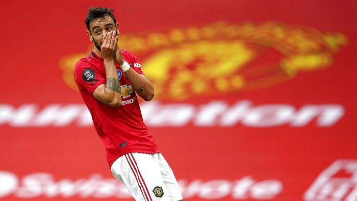 Manchester Uniteds Bruno Fernandes reacts after a play during the English Premier League soccer match between Manchester United and Bournemouth at Old Trafford stadium in Manchester, England, Saturday, July 4, 2020. (AP Photo/Dave Thompson, Pool)