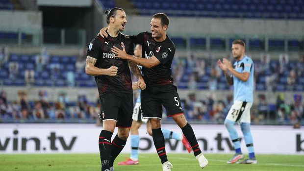 AC Milan's Zlatan Ibrahimovic, left, celebrates with Giacomo Bonaventura after scoring his side's 2nd goal on a penalty, during the Serie A soccer match between Lazio and AC Milan at the Rome Olympic stadium, Saturday, July 4, 2020. (Spada/LaPresse via AP)