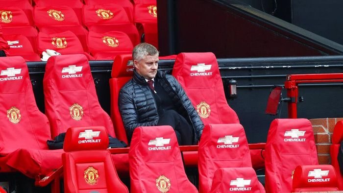 Manchester Uniteds manager Ole Gunnar Solskjaer, center, looks on from the bench during the English Premier League soccer match between Manchester United and Bournemouth at Old Trafford stadium in Manchester, England, Saturday, July 4, 2020. (Clive Brunskill/Pool via AP)