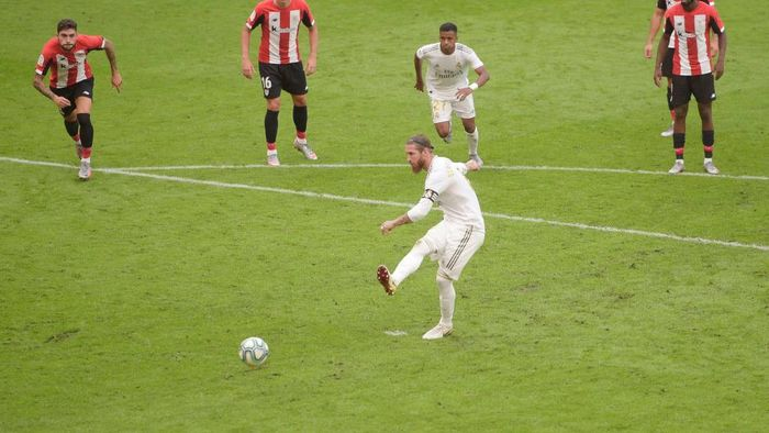 BILBAO, SPAIN - JULY 05: Sergio Ramos of Real Madrid scores a penalty for his teams first goal during the La Liga match between Athletic Club and Real Madrid CF at San Mames Stadium on July 05, 2020 in Bilbao, Spain. Football Stadiums around Europe remain empty due to the Coronavirus Pandemic as Government social distancing laws prohibit fans inside venues resulting in all fixtures being played behind closed doors. (Photo by Juan Manuel Serrano Arce/Getty Images)