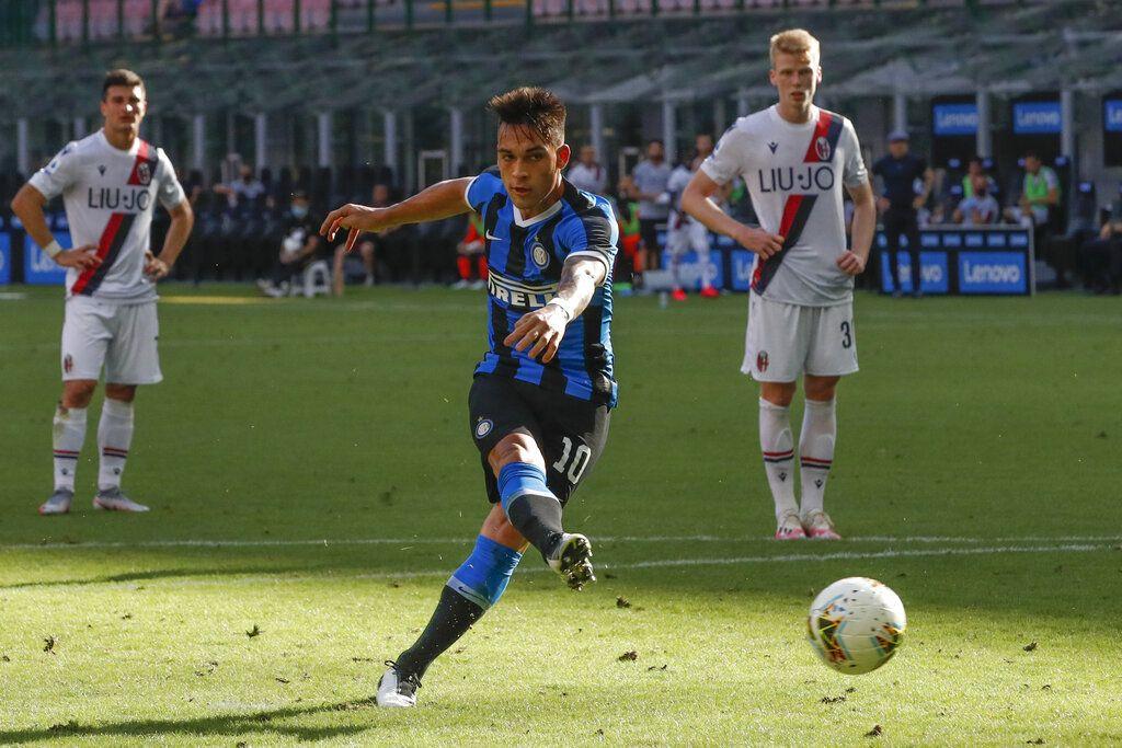 Inter Milan's Lautaro Martinez misses a penalty kick during the Serie A soccer match between Inter Milan and Bologna at the Milan San Siro Stadium, Italy, Sunday, July 5, 2020. (AP Photo/Antonio Calanni)