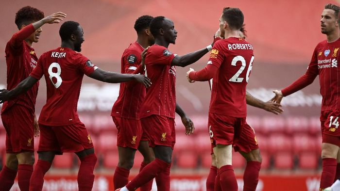 Liverpools Sadio Mane, center, celebrates after scoring the opening goal during the English Premier League soccer match between Liverpool and Aston Villa at Anfield Stadium in Liverpool, England, Sunday, July 5, 2020. (Shaun Botterill/Pool via AP)