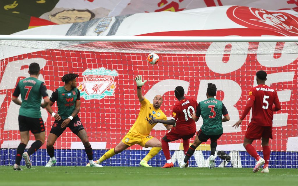LIVERPOOL, ENGLAND - JULY 05: Sadio Mane of Liverpool scores his team's first goal past Pepe Reina of Aston Villa during the Premier League match between Liverpool FC and Aston Villa at Anfield on July 05, 2020 in Liverpool, England.Football Stadiums around Europe remain empty due to the Coronavirus Pandemic as Government social distancing laws prohibit fans inside venues resulting in games being played behind closed doors. (Photo by Carl Recine/Pool via Getty Images)