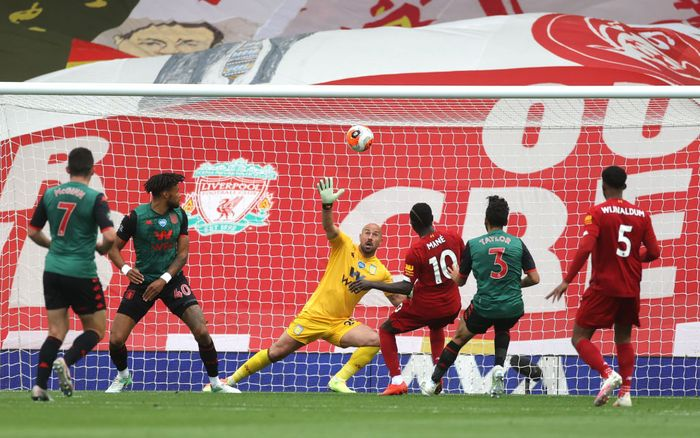 LIVERPOOL, ENGLAND - JULY 05: Sadio Mane of Liverpool scores his teams first goal past Pepe Reina of Aston Villa during the Premier League match between Liverpool FC and Aston Villa at Anfield on July 05, 2020 in Liverpool, England.Football Stadiums around Europe remain empty due to the Coronavirus Pandemic as Government social distancing laws prohibit fans inside venues resulting in games being played behind closed doors. (Photo by Carl Recine/Pool via Getty Images)