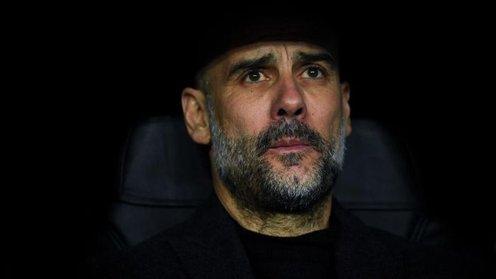 MADRID, SPAIN - FEBRUARY 26: Josep Guardiola, manager of Manchester City FC looks on during the UEFA Champions League round of 16 first leg match between Real Madrid and Manchester City at Bernabeu on February 26, 2020 in Madrid, Spain. (Photo by David Ramos/Getty Images)